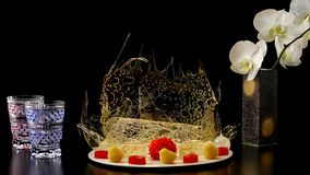 Selection of decorative desserts on dark background stock images