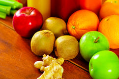 Selection of delicious fruits and vegetables spread out on wooden surface, beautiful colors, healthy lifestyle concept Royalty Free Stock Image