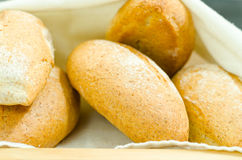 Selection of delicous bread buns lying in basket, as seen from above.  royalty free stock photography