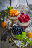 Selection of desserts with berries and fruits. Rustic wood background Stock Photo