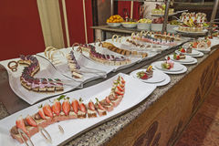 Selection of desserts on display at a restaurant buffet Royalty Free Stock Photos