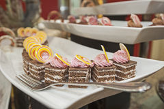 Selection of desserts on display at a restaurant buffet Royalty Free Stock Photography