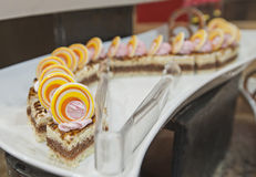 Selection of desserts on display at a restaurant buffet Stock Photography