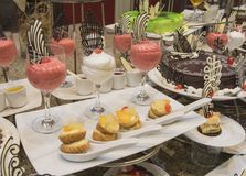 Selection of desserts on display at a restaurant buffet Royalty Free Stock Photo