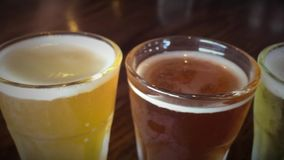 Selection of different beer types. Shot of Selection of different beer types stock video footage