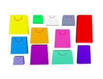Selection of different coloured shopping bags on white backgroun. 3d coloured paer bags isolated on white Royalty Free Stock Photos