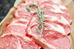 Selection of different cuts of fresh raw red meat in a supermarket.  Royalty Free Stock Images