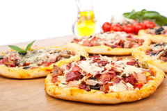 Selection Of Different Pizzas on Wooden Table Stock Photography