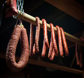 Selection of different types of salami on display Royalty Free Stock Photo
