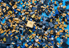Selection of Electronic Components. A selection of surface mount electronic components ranging from resistors and capacitors to transistors and integrated stock images
