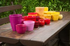 Colorful decorative ceramic planting pots royalty free stock photo