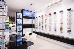 Selection of eyeglasses. Selection of modern eyeglasses rims at optician's store Stock Photo
