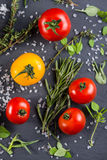 Selection of farm fresh tomatoes with herbs and sea salt from ab Stock Images