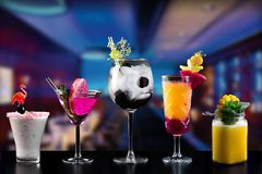 Cocktails alcohol bar selection trendy hotel bartender garnish. Selection of fine non alcoholic garnished cocktail drinks beverage bar club mixologist beer royalty free stock image