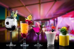 Cocktails alcohol bar selection trendy hotel bartender garnish. Selection of fine non alcoholic garnished cocktail drinks beverage bar club mixologist beer royalty free stock photo