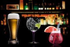 Cocktails alcohol bar selection trendy hotel bartender garnish stock photos