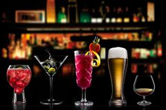 Cocktails alcohol bar selection trendy hotel bartender garnish royalty free stock images