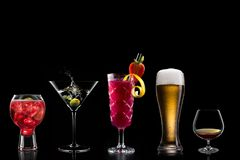 Cocktails alcohol bar selection trendy hotel bartender garnish stock photography
