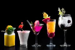 Cocktails alcohol bar selection trendy hotel bartender garnish. Selection of fine non alcoholic garnished cocktail drinks beverage bar club mixologist beer royalty free stock photography