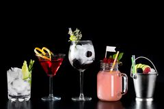 Cocktails alcohol bar selection trendy hotel bartender garnish royalty free stock image