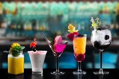 Cocktails alcohol bar selection trendy hotel bartender garnish. Selection of fine non alcoholic garnished cocktail drinks beverage bar club mixologist beer royalty free stock images