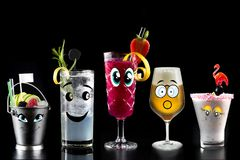 Faces Cocktails alcohol bar selection trendy hotel bartender garnish. Selection of fine non alcoholic garnished cocktail drinks beverage bar club mixologist beer royalty free stock photo