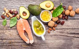 Selection food sources of omega 3 and unsaturated fats. Superfoo. D high vitamin e and dietary fiber for healthy food. Almond,pecan,hazelnuts,walnuts,olive oil Royalty Free Stock Image