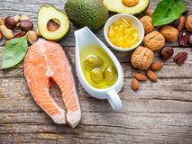Selection food sources of omega 3 and unsaturated fats. Superfoo. D high vitamin e and dietary fiber for healthy food. Almond,pecan,hazelnuts,walnuts,olive oil Stock Photos