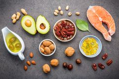 Selection food sources of omega 3 and unsaturated fats. Superfoo. D high vitamin e and dietary fiber for healthy food. Almond ,pecan,hazelnuts,walnuts,olive oil Stock Photo
