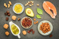 Selection food sources of omega 3 and unsaturated fats. Superfoo. D high vitamin e and dietary fiber for healthy food. Almond ,pecan,hazelnuts,walnuts,olive oil Royalty Free Stock Photo