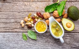 Selection food sources of omega 3 and unsaturated fats. Superfoo. D high vitamin e and dietary fiber for healthy food. Almond,pecan,hazelnuts,walnuts,olive oil Royalty Free Stock Photography