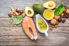 Selection food sources of omega 3 and unsaturated fats. Superfoo. D high vitamin e and dietary fiber for healthy food. Almond,pecan,hazelnuts,walnuts,olive oil Stock Photo