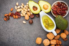 Selection food sources of omega 3 and unsaturated fats. Superfoo. D high vitamin e and dietary fiber for healthy food. Almond ,pecan,hazelnuts,walnuts,olive oil Royalty Free Stock Photos