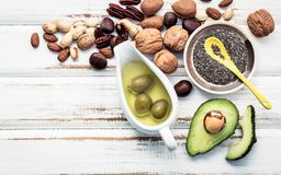 Selection food sources of omega 3 and unsaturated fats. Superfoo. D high vitamin e and dietary fiber for healthy food. Almond ,pecan,hazelnuts,walnuts and olive Royalty Free Stock Photography