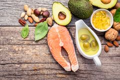 Selection food sources of omega 3 and unsaturated fats. Superfoo. D high vitamin e and dietary fiber for healthy food. Almond,pecan,hazelnuts,walnuts,olive oil Royalty Free Stock Photo