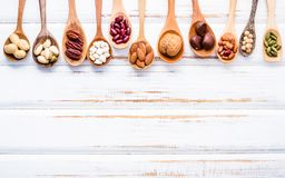 Selection food sources of omega 3 and unsaturated fats. Superfoo. D high vitamin e and dietary fiber for healthy food. Mixed nuts almond ,pecan,hazelnuts,walnuts Royalty Free Stock Images