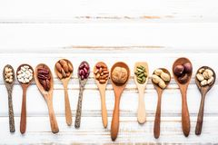 Selection food sources of omega 3 and unsaturated fats. Superfoo. D high vitamin e and dietary fiber for healthy food. Mixed nuts almond ,pecan,hazelnuts,walnuts Royalty Free Stock Image