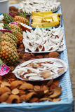 Selection of fresh coconut snacks on a traditional Moroccan market Stock Image