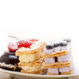 Selection of fresh cream cake dessert plate Royalty Free Stock Images