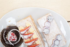 Selection of fresh cream cake dessert plate Royalty Free Stock Photography