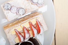 Selection of fresh cream cake dessert plate Stock Photography