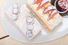 Selection of fresh cream cake dessert plate Stock Photos