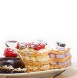 Selection of fresh cream cake dessert plate Stock Photography