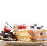 Selection of fresh cream cake dessert plate Royalty Free Stock Photo