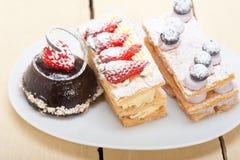 Selection of fresh cream cake dessert plate Royalty Free Stock Image