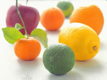 Selection of fresh fruit arranged in the heart shape on white wooden table. Selective focus on the front Stock Photo