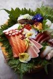 Sashimi selection with decoration. Selection of fresh high qulity Sashimi stock photography