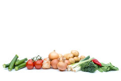 A selection of fresh raw vegetables. Selection of fresh raw vegetables including courgettes, tomatoes, onions, potatoes, leeks, brocolli and mangetout with Stock Photos