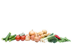 A selection of fresh raw vegetables. Selection of fresh raw vegetables including courgettes, tomatoes, onions, potatoes, leeks, brocolli and mangetout with Stock Images