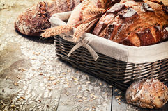 Selection of freshly baked bread in wicker basket Royalty Free Stock Photo